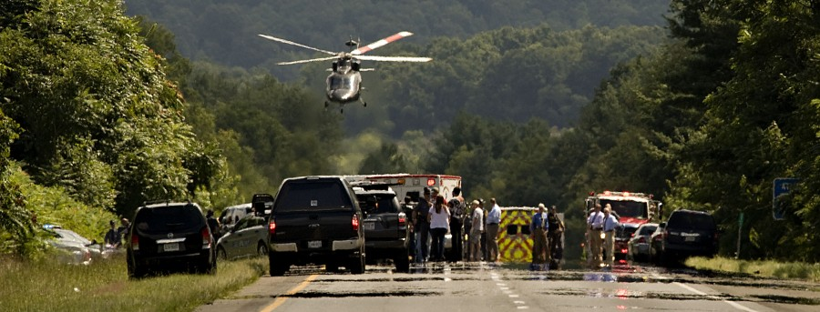 A helicopter lifts off from eastbound Interstate 66 near Markham where the suspect in the murders of a TV reporter and cameraman ran his car off the road during a police pursuit. The suspect,  Vester Lee Flanagan II, 41, of Roanoke, died later at the hospital from a self-inflicted gunshot wound.  Rich Cooley/Daily
